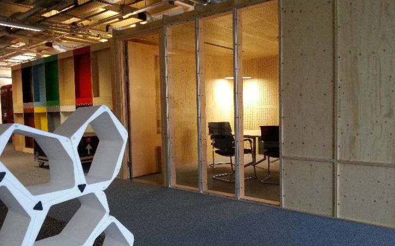 Acoustically insulated modular video-conferencing room designed for Google